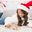 Festive little girl eating cookies — Stock Photo #57266891
