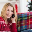 Happy woman relaxing on couch talking on phone — Stock Photo #57267125