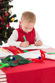 Festive little boy drawing pictures — Zdjęcie stockowe