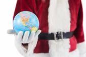 Santa has a globe in his hand — Stock Photo
