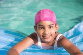 Cute little girls swimming in the pool — Foto de Stock