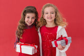 Festive little girls holding gifts — Foto de Stock