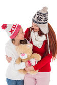 Mother and daughter holding teddy bear — Foto de Stock