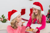 Festive mother and daughter with plate of cookies — Foto Stock