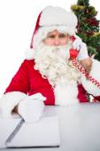 Annoyed santa claus on the phone — Stock Photo
