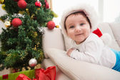 Cute baby boy on couch at christmas — Stock Photo