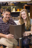Young couple discussing the menu — Stock Photo