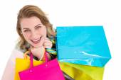 Overhead of a woman holding many shopping bags  — Stock Photo