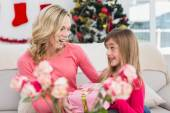 Little girl giving her mother a christmas gift — Stock Photo