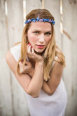 Pretty blonde woman posing while wearing headband — Stock Photo