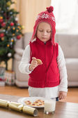 Festive little boy holding a cookie — Stock Photo