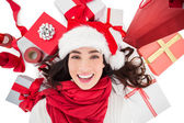 Festive brunette lying near christmas presents  — Stock Photo