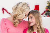 Festive mother and daughter smiling at each other — Stock Photo