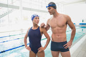 Male and female swimmers by pool — Foto de Stock