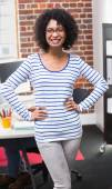 Young businesswoman with hands on hips — Stock Photo