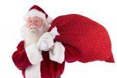 Santa trägt seine rote Tasche und lächelt — Stockfoto