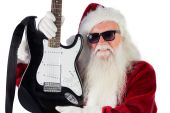 Father Christmas shows a guitar — Stock Photo