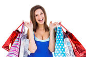 Cheerful brunette woman holding shopping bags — Stock Photo