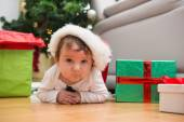 Cute baby boy lying on floor at christmas — Photo
