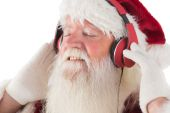 Santa Claus enjoying some music — Stock Photo