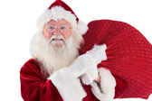 Jolly Santa carries his sack — Stock Photo