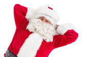 Happy santa lying and relaxing  — Stock Photo