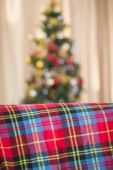 Warm blanket on the couch at christmas — Stock Photo