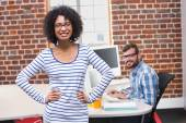 Smiling businesswoman with hands on hips — Stock Photo