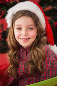 Festive little girl smiling at camera — Stockfoto