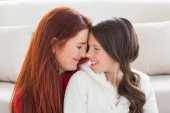 Mother and daughter smiling at each other — Stock Photo