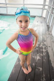 Cute little girl standing poolside — Stock Photo