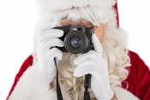 Portrait of santa taking a photo — Stock Photo