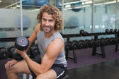 Man exercising with dumbbell in gym — Foto de Stock