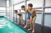 Cute swimming class about to jump in pool — Stockfoto