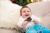 Cute baby boy on the couch at christmas — Zdjęcie stockowe