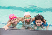 Cute little kids in the swimming pool — Stock Photo
