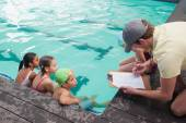 Cute swimming class listening to coach — Fotografia Stock