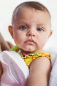 Cute baby wrapped in towel — Stock Photo