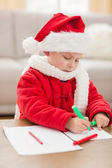 Festive little boy drawing pictures — Stockfoto