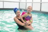 Cute little girl learning to swim with coach — Foto de Stock