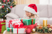Cute little girl surrounded by christmas gifts — Zdjęcie stockowe