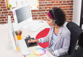 Female photo editor using digitizer in office — Stock Photo