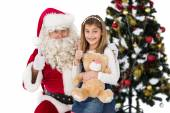 Little girl with santa claus — Stockfoto