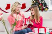 Festive mother and daughter with many gifts — Foto de Stock