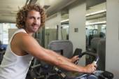 Man working out on exercise bike — Foto Stock