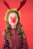 Festive little girl wearing red nose — Stock Photo