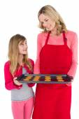 Festive mother and daughter making christmas cookies — Stock Photo
