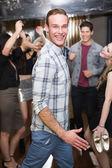 Stylish man smiling on the dancefloor — Stock Photo