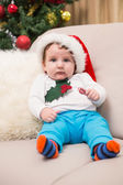 Cute baby boy on couch at christmas — ストック写真
