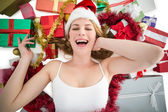 Smiling woman laying on the floor with gifts and garland — Foto de Stock